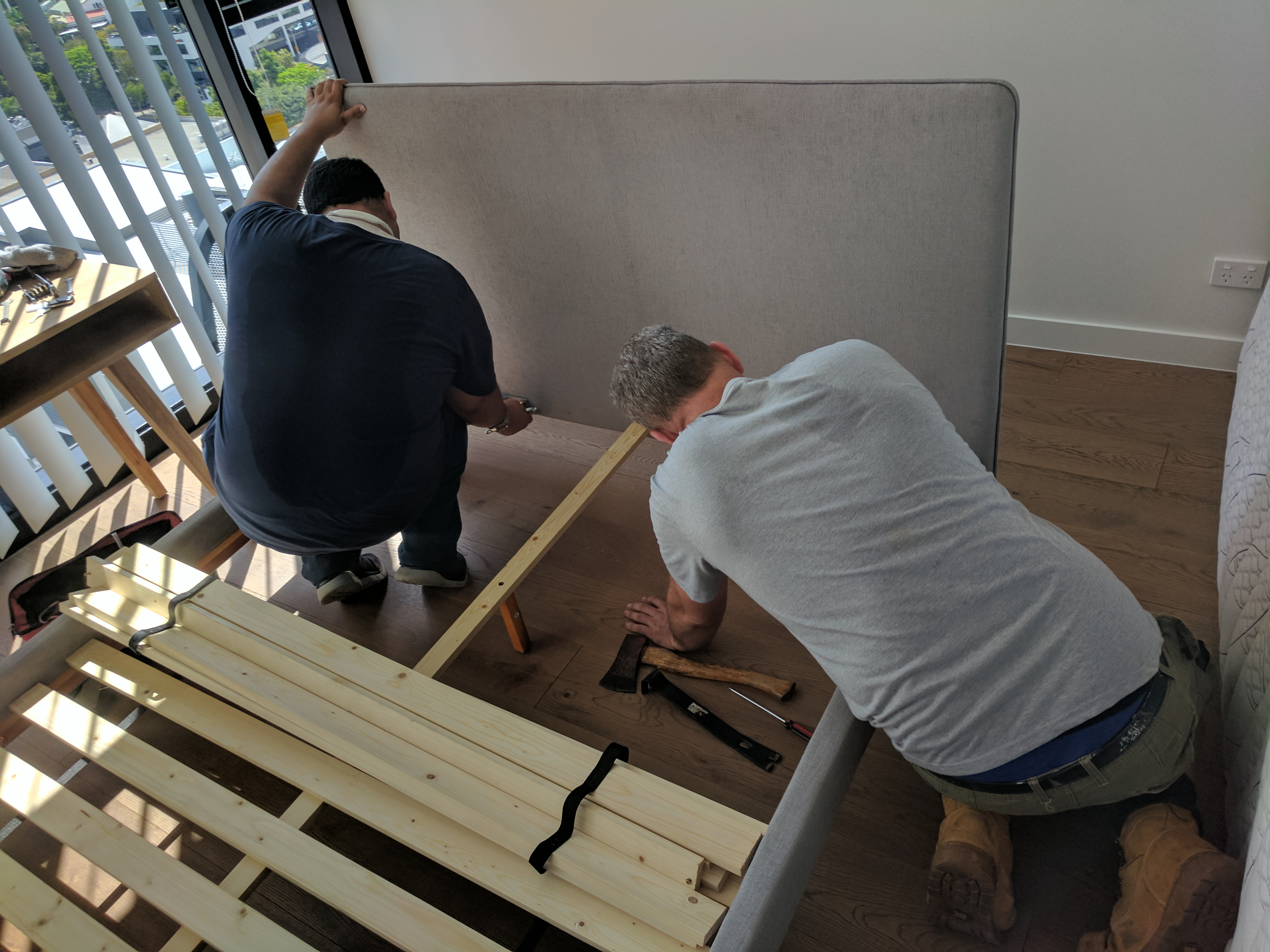 removalists dismantle bed